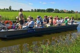 Met de fluisterboot op zoek naar eetbare planten in Eilandspolder